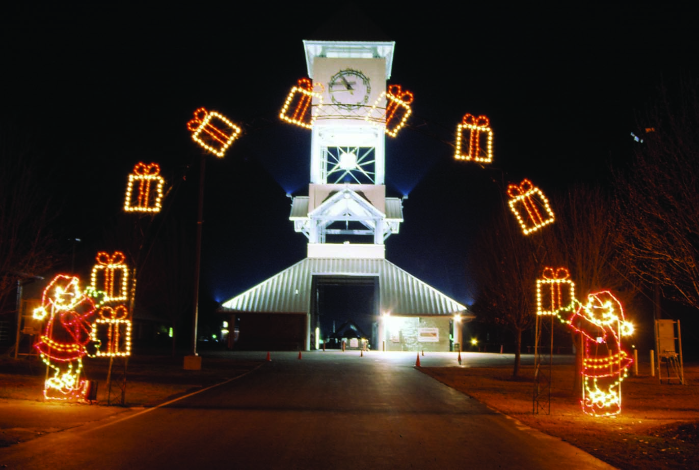 Lighted arch outdoor Christmas decorations illustrated on the Holiday Designs Christmas decorations web site are ready to install.